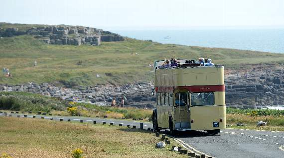 Transport by vintage bus to Golf's Open Championship