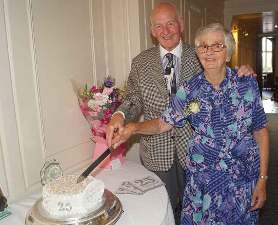 Group Founder Members Bette Wilson And Derek Lyddon Cut The Celebration Cake Made By Member Jacqui Miles